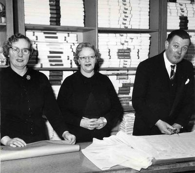 One male and two female employees in the Linen Department, JF Rockhey Ltd