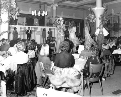 Models on the catwalk in evening gowns at the Helena Geffers fashion show held at Dickins and Jones in September 1951.