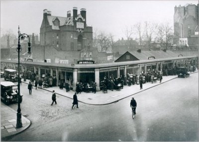Winter scene of shop front at John Barker's and Co., Kensington, 1921