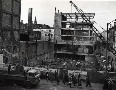 Rebuilding foundations of William Henderson & Sons after fire, 1962.
